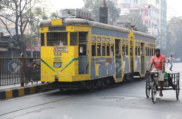 27811315-Traditional-tram-downtown-Kolkata-on-February-15-2014-Kolkata-is-the-only-Indian-city-with-a-tram-ne-Stock-Photo